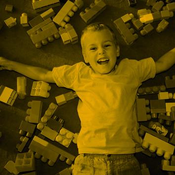 boy laying on floor in playroom