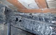 Evaluación mediante ultrasonidos de viguetas apeadas de una estructura parcialmente quemada